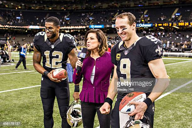 Drew Brees and Marques Colston of the New Orleans Saints talks with Michele Tafoya after a game against the Carolina Panthers at MercedesBenz...