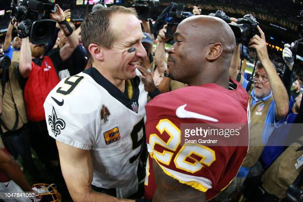 Drew Brees of the New Orleans Saints and Adrian Peterson of the Washington Redskins talk after a game at the MercedesBenz Superdome on October 8 2018...