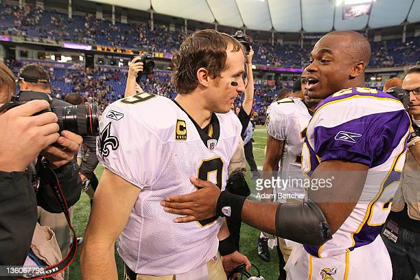 Drew Brees of the New Orleans Saints and Adrian Peterson of the Minnesota Vikings shake hands at the Hubert H Humphrey Metrodome on December 18 2011...
