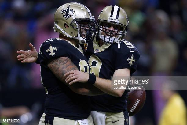 Drew Brees of the New Orleans Saints and Michael Hoomanawanui celebrate a touchdown during the second half of a game against the Detroit Lions at the...