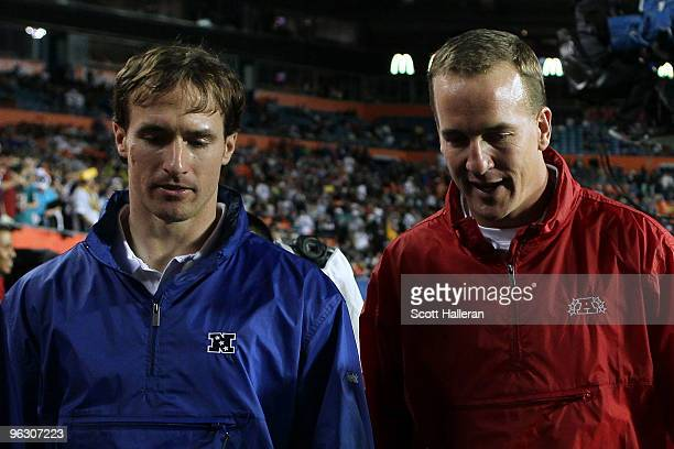 Drew Brees of the New Orleans Saints and Peyton Manning of the Indianapolis Colts walk on the field during 2010 AFCNFC Pro Bowl at Sun Life Stadium...