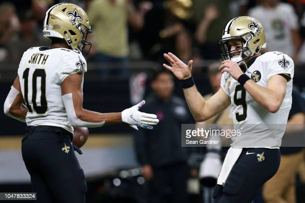 Drew Brees of the New Orleans Saints and Tre'Quan Smith celebrate a touchdown during the second half against the Washington Redskins at the...