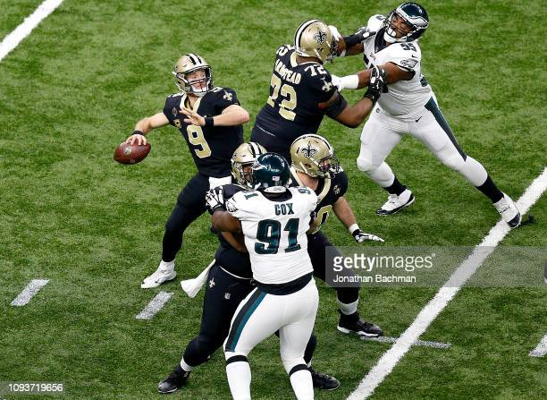Drew Brees of the New Orleans Saints attempts a pass during the first quarter against the Philadelphia Eagles in the NFC Divisional Playoff Game at...