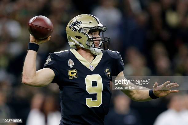 Drew Brees of the New Orleans Saints attempts a pass during the second quarter against the Philadelphia Eagles in the NFC Divisional Playoff Game at...