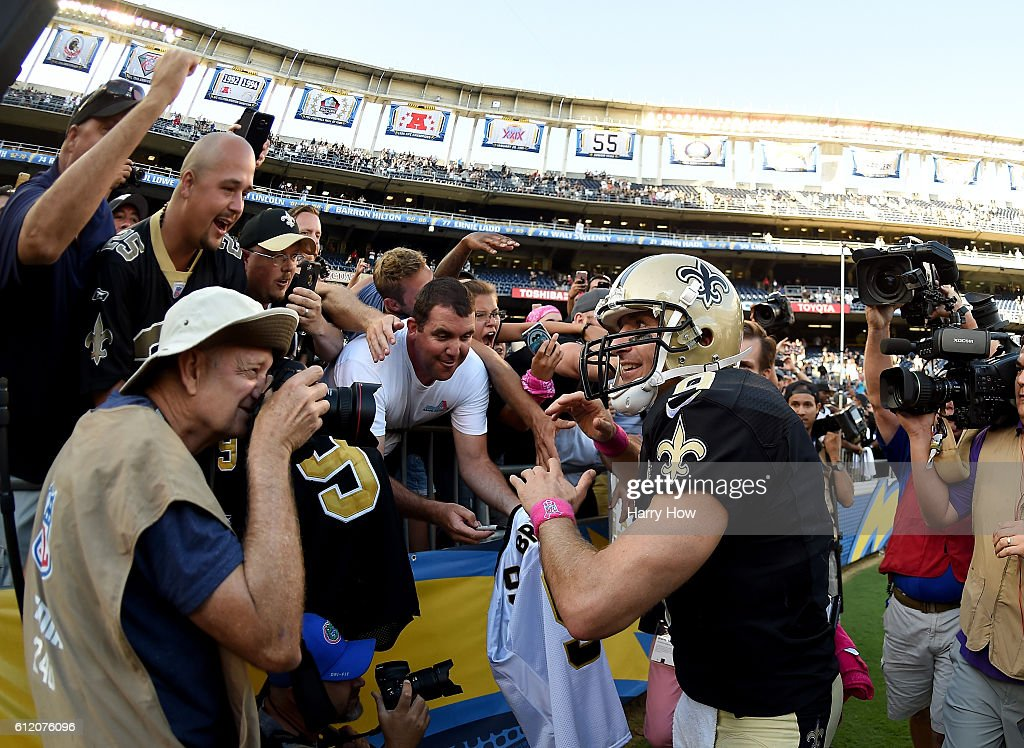 Drew Brees #9 of the New Orleans Saints celebrates a 35-34 come from behind victory over the San Diego Chargers with fans at Qualcomm Stadium on October 2, 2016 in San Diego, California.