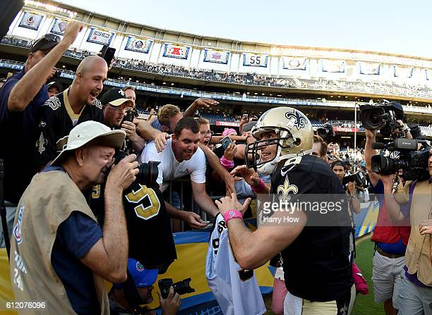 Drew Brees of the New Orleans Saints celebrates a 3534 come from behind victory over the San Diego Chargers with fans at Qualcomm Stadium on October...