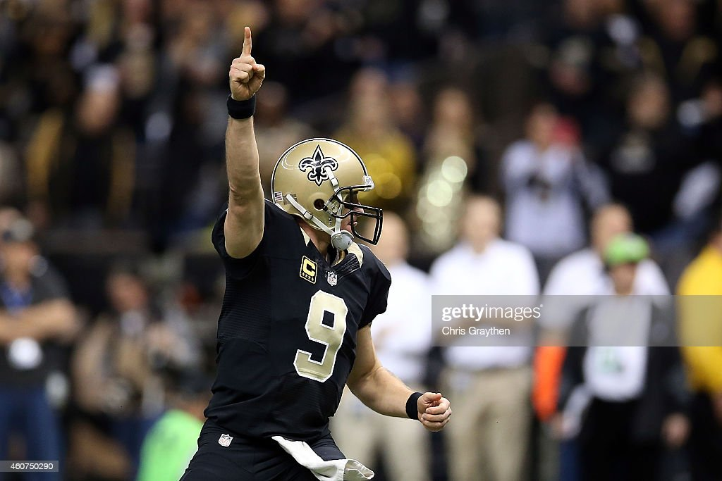 Drew Brees #9 of the New Orleans Saints celebrates a touchdown during the first quarter of a game against the Atlanta Falcons at the Mercedes-Benz Superdome on December 21, 2014 in New Orleans, Louisiana.