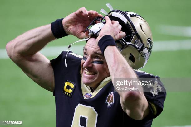 Drew Brees of the New Orleans Saints celebrates after defeating the Chicago Bears with a score of 21 to 9 in the NFC Wild Card Playoff game at...