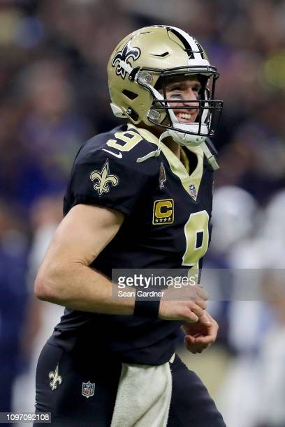 Drew Brees of the New Orleans Saints celebrates after Garrett Griffin scored a touchdown against the Los Angeles Rams during the first quarter in the...