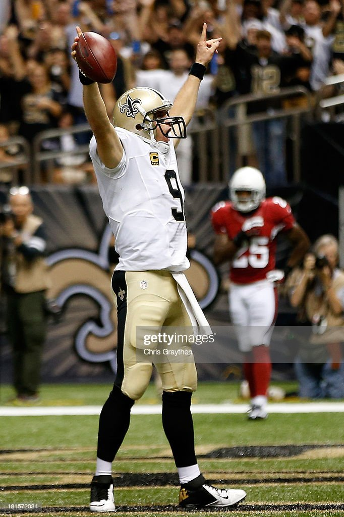 Drew Brees #9 of the New Orleans Saints celebrates after running the ball in for a touchdown against the Arizona Cardinals at the Mercedes-Benz Superdome on September 22, 2013 in New Orleans, Louisiana.