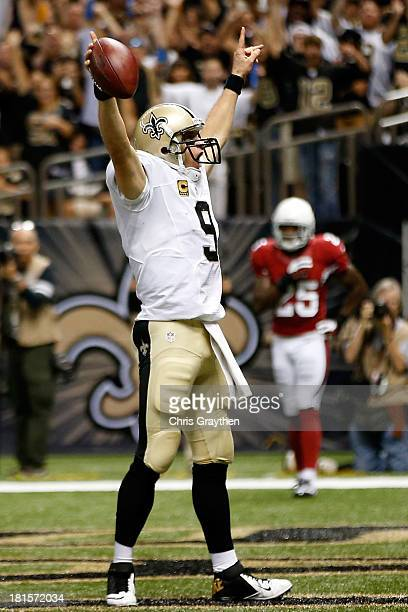 Drew Brees of the New Orleans Saints celebrates after running the ball in for a touchdown against the Arizona Cardinals at the MercedesBenz Superdome...