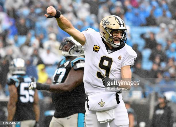 Drew Brees of the New Orleans Saints celebrates after throwing for a touchdown against the Carolina Panthers during the third quarter of their game...