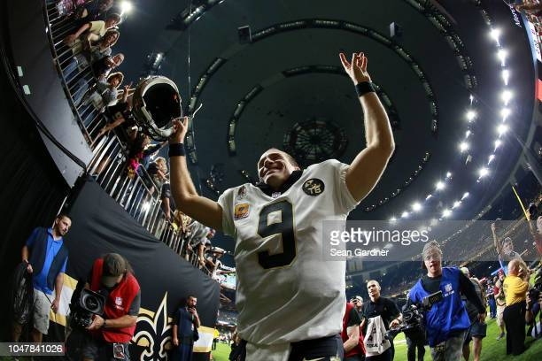 Drew Brees of the New Orleans Saints celebrates after winning a game against the Washington Redskins at the MercedesBenz Superdome on October 8 2018...