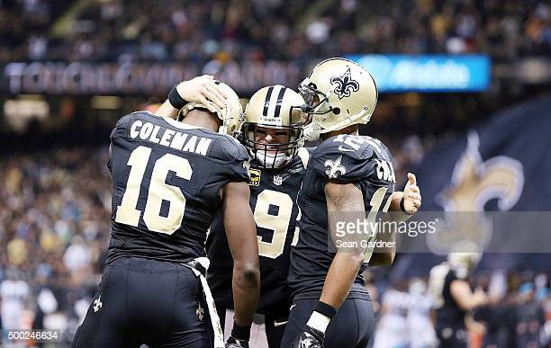 Drew Brees of the New Orleans Saints celebrates with Brandon Coleman of the New Orleans Saints and Marques Colston of the New Orleans Saints after...