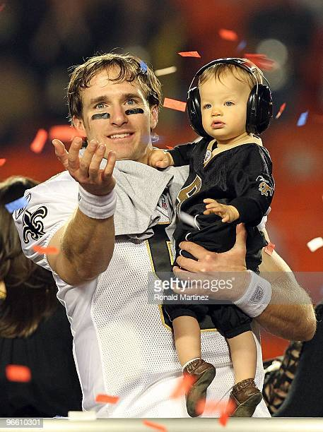 Drew Brees of the New Orleans Saints celebrates with his son Baylen Brees after defeating the Indianapolis Colts during Super Bowl XLIV on February...