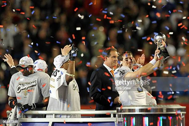 Drew Brees of the New Orleans Saints celebrates with the Vince Lombardi trophy at the end of Super Bowl XLIV on February 7 2010 at Sun Life Stadium...