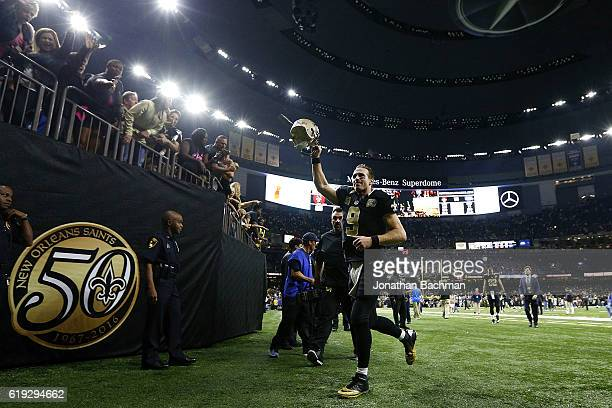 Drew Brees of the New Orleans Saints celerbates after a game against the Seattle Seahawks at the MercedesBenz Superdome on October 30 2016 in New...