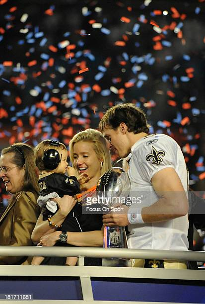 Drew Brees of the New Orleans Saints cherishes the moment with his wife Brittany and one year old son Baylen Robert Brees after the Saints defeated...