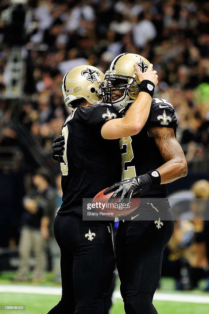 Drew Brees #9 of the New Orleans Saints congratulates Marques Colston following a touchdown against the San Francisco 49ers during a game at the Mercedes-Benz Superdome on November 25, 2012 in New Orleans, Louisiana.