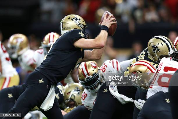 Drew Brees of the New Orleans Saints dives for a one yard touchdown against the San Francisco 49ers during the second quarter in the game at Mercedes...