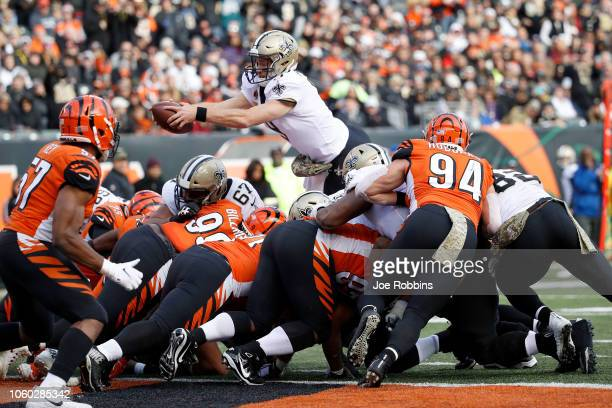 Drew Brees of the New Orleans Saints dives for a touchdown during the third quarter of the game against the Cincinnati Bengals at Paul Brown Stadium...
