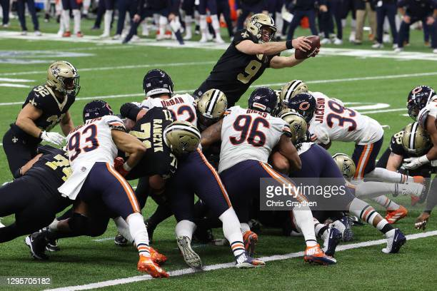 Drew Brees of the New Orleans Saints dives in the end zone to score a one yard touchdown against the Chicago Bears during the fourth quarter in the...