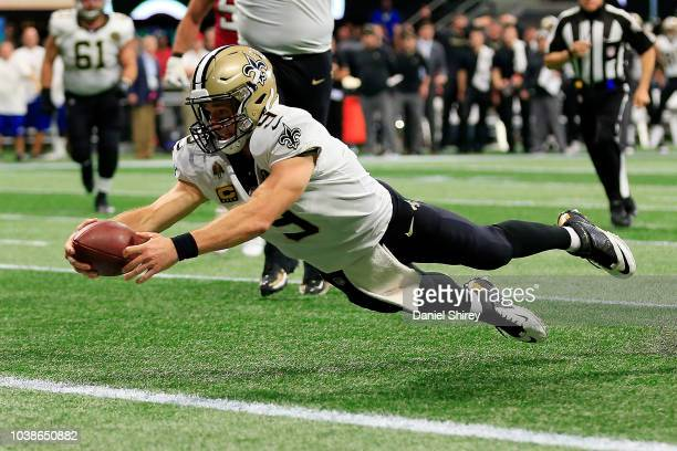 Drew Brees of the New Orleans Saints dives into the end zone for a touchdown during the fourth quarter against the Atlanta Falcons at MercedesBenz...