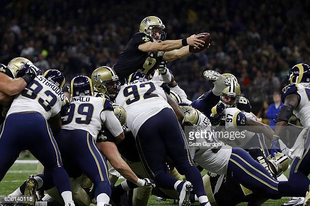 Drew Brees of the New Orleans Saints drives for a touchdown during the first half of a game against the Los Angeles Rams at the MercedesBenz...
