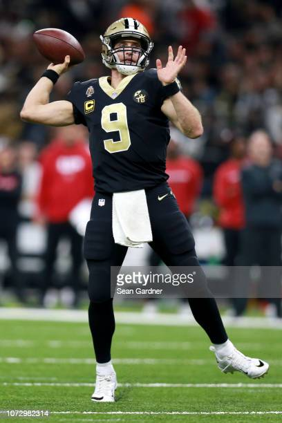 Drew Brees of the New Orleans Saints drops back to pass during a game against the Atlanta Falcons during a game at the MercedesBenz Superdome on...