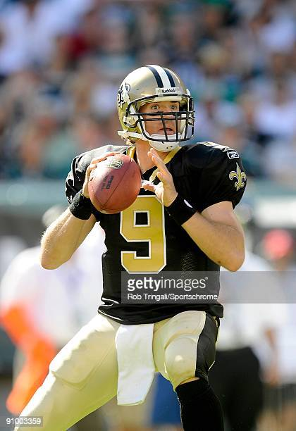 Drew Brees of the New Orleans Saints drops back to pass during a game against the Philadelphia Eagles at Lincoln Financial Field in Philadelphia,...
