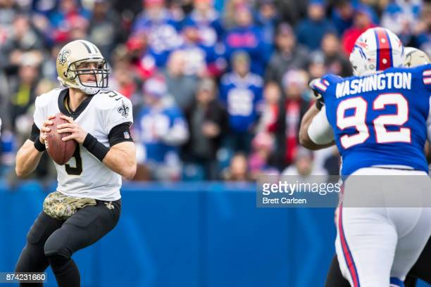Drew Brees of the New Orleans Saints drops back to pass during the second quarter against the Buffalo Bills at New Era Field on November 12 2017 in...