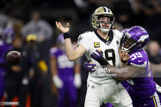 Drew Brees of the New Orleans Saints fumbles the ball as he is sacked by Danielle Hunter of the Minnesota Vikings during the fourth quarter in the...