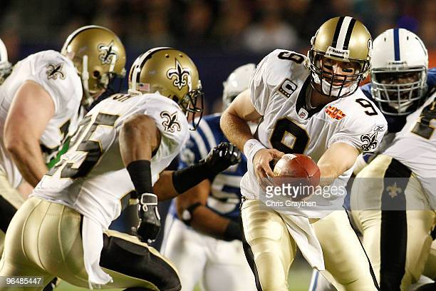 Drew Brees of the New Orleans Saints hands off to Reggie Bush against the Indianapolis Colts during Super Bowl XLIV on February 7, 2010 at Sun Life...