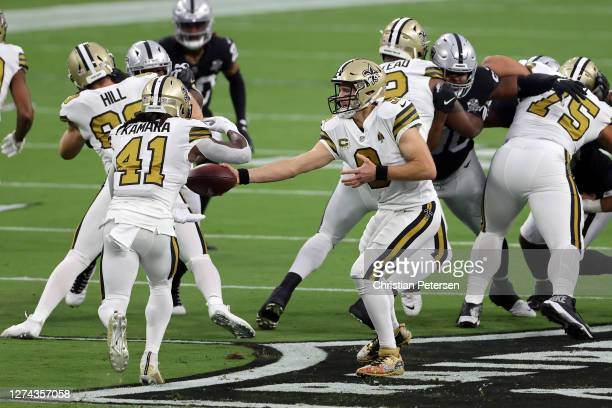 Drew Brees of the New Orleans Saints hands the ball off to Alvin Kamara in the first quarter against the Las Vegas Raiders at Allegiant Stadium on...