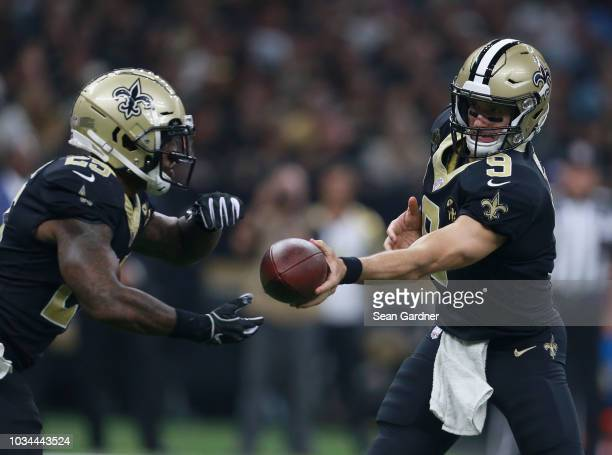 Drew Brees of the New Orleans Saints hands the ball off to Mike Gillislee of the New Orleans Saints during the second quarter against the Cleveland...