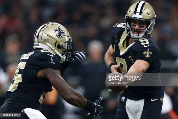 Drew Brees of the New Orleans Saints hands the ball off to Mike Gillislee of the New Orleans Saints during a game against the Cleveland Browns at...