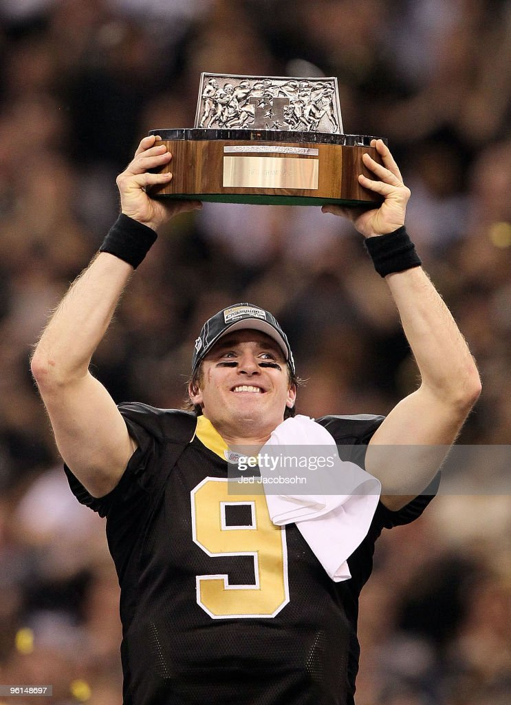 Drew Brees #9 of the New Orleans Saints holds up the NFC Championship trophy after defeating the Minnesota Vikings to win the NFC Championship Game at the Louisiana Superdome on January 24, 2010 in New Orleans, Louisiana.