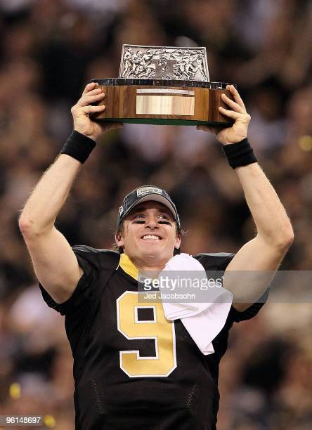 Drew Brees of the New Orleans Saints holds up the NFC Championship trophy after defeating the Minnesota Vikings to win the NFC Championship Game at...