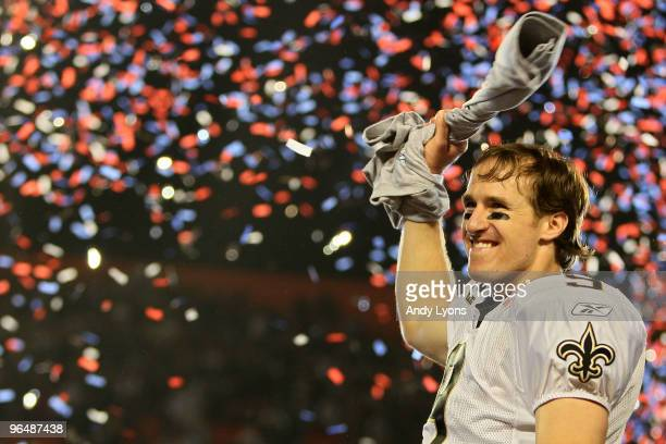 Drew Brees of the New Orleans Saints holds up the Vince Lombardi Trophy after defeating the Indianapolis Colts during Super Bowl XLIV on February 7...