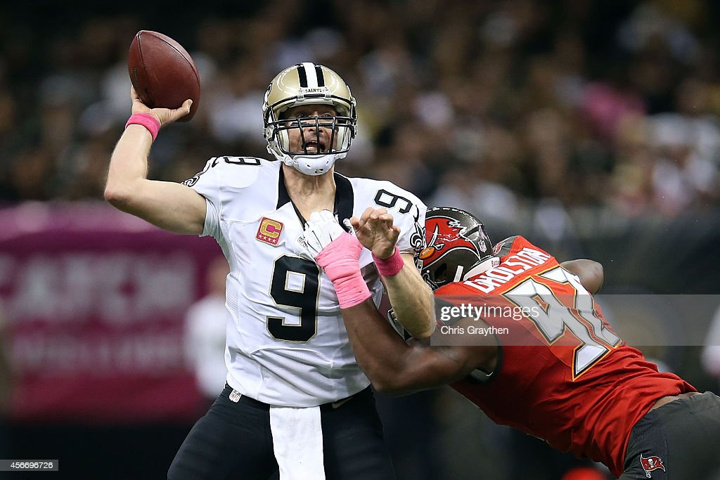 Drew Brees #9 of the New Orleans Saints is pressured by William Gholston #92 of the Tampa Bay Buccaneers during the fourth quarter of a game at the Mercedes-Benz Superdome on October 5, 2014 in New Orleans, Louisiana.