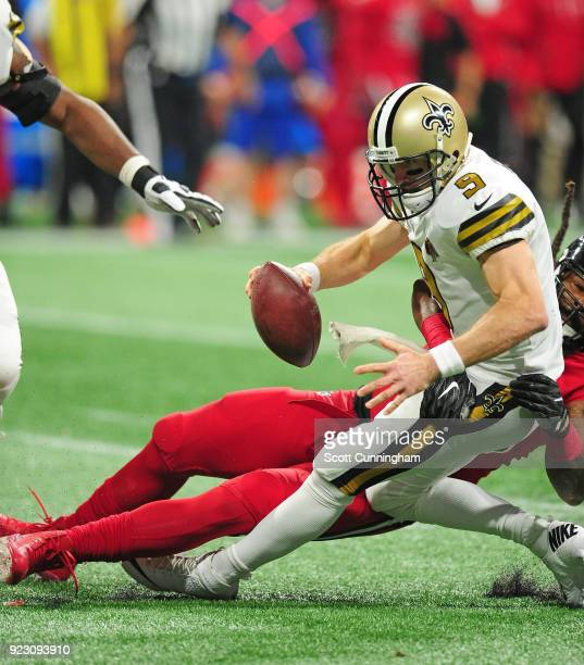 Drew Brees of the New Orleans Saints is sacked by Adrian Clayborn of the Atlanta Falcons at MercedesBenz Stadium on December 7 2017 in Atlanta Georgia