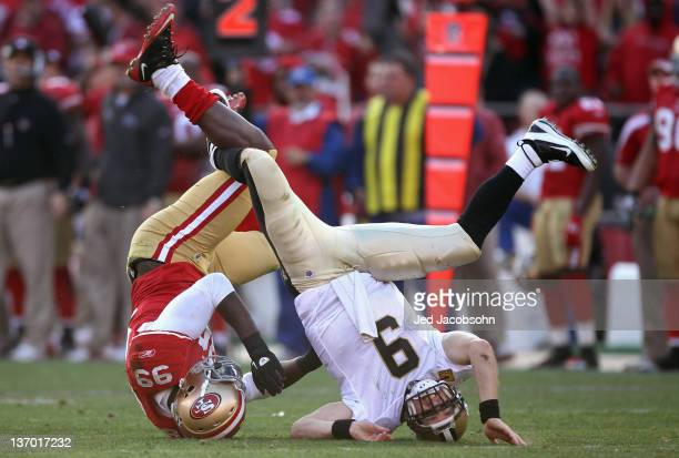 Drew Brees of the New Orleans Saints is sacked by Aldon Smith of the San Francisco 49ers in the third quarter of the NFC Divisional playoff game at...