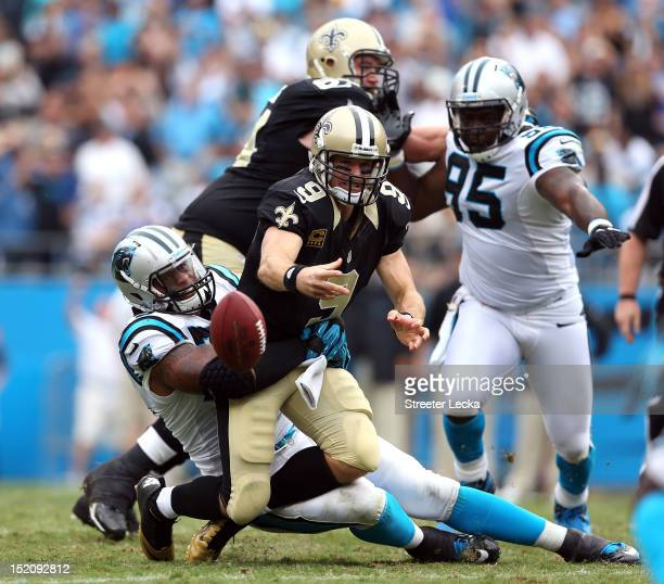 Drew Brees of the New Orleans Saints is sacked by Greg Hardy of the Carolina Panthers during their game at Bank of America Stadium on September 16...