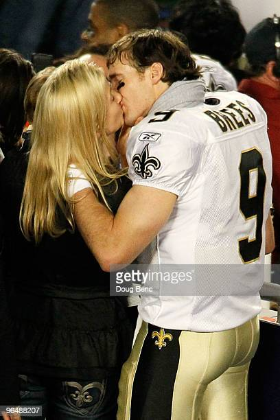 Drew Brees of the New Orleans Saints kisses his wife Brittany Brees after defeating the Indianapolis Colts during Super Bowl XLIV on February 7 2010...