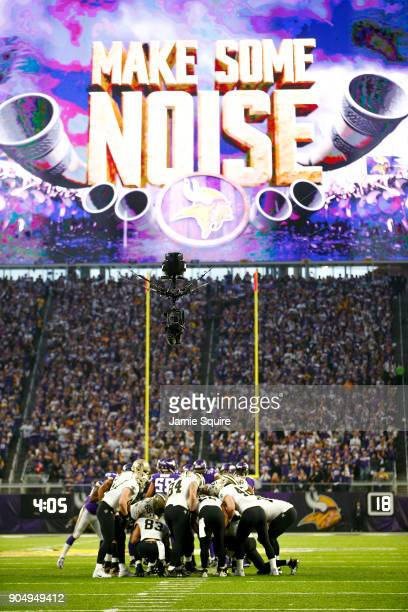 Drew Brees of the New Orleans Saints leads a huddle against the Minnesota Vikings during the first half of the NFC Divisional Playoff game at US Bank...
