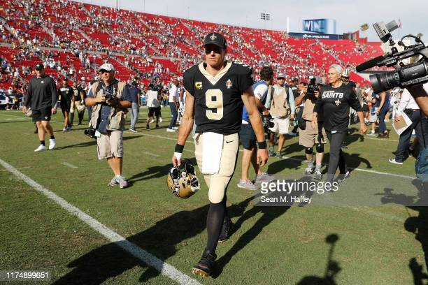 Drew Brees of the New Orleans Saints leaves the field after being defeated by the Los Angeles Rams 279 at Los Angeles Memorial Coliseum on September...