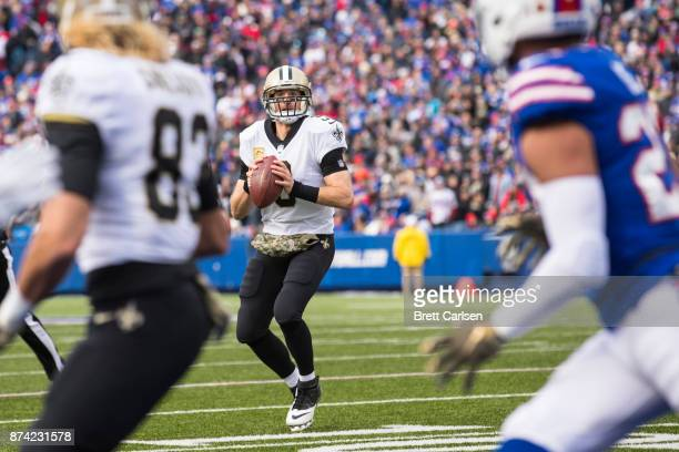 Drew Brees of the New Orleans Saints looks downfield before throwing the ball out of bounds during the second quarter against the Buffalo Bills at...