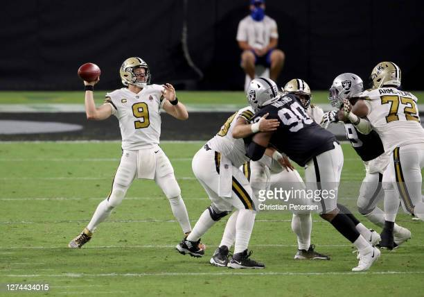 Drew Brees of the New Orleans Saints looks to throw a pass against the Las Vegas Raiders at Allegiant Stadium on September 21 2020 in Las Vegas Nevada