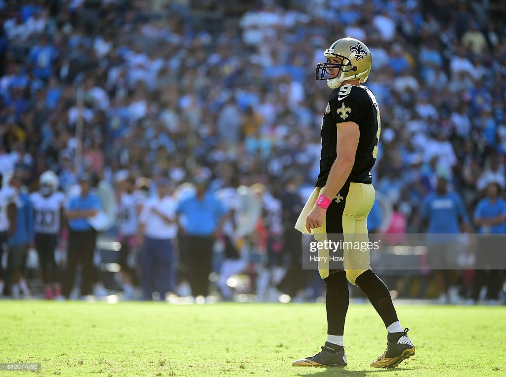 Drew Brees #9 of the New Orleans Saints looks up at the clock trailing the San Diego Chargers during the fourth quarter at Qualcomm Stadium on October 2, 2016 in San Diego, California.