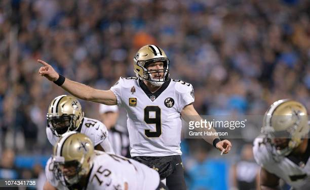 Drew Brees of the New Orleans Saints makes a call at the line against the Carolina Panthers in the second quarter during their game at Bank of...